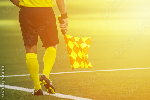 Photo Assistant referee moving along the sideline during a soccer match