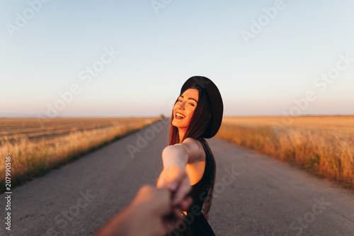 Portrait of stylish women on the road at sunset