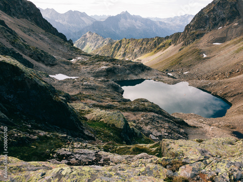 Foto op Canvas Bergen Dramatic Rocky Alpine Landscape With Small Glacial Lake