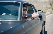 Woman With Arm Out Cruising In...