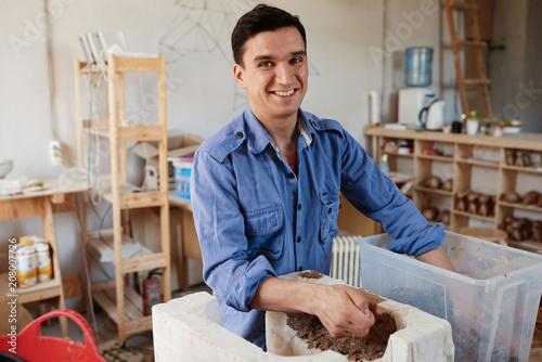 Happy papier mache master at work