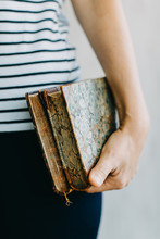 A Woman Holding  Vintage Books