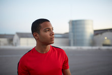 Profile Of A Young African American With Sportswear  In An Industrial Street Of A City