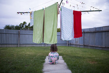 A Toddler Sits In Front Of The...