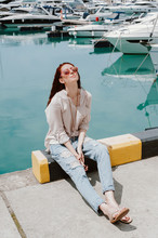 Woman Enjoys Sunny Day At A Pier