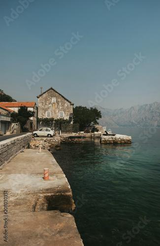 Papiers peints Europe Méditérranéenne Bay of Kotor,Montenegro.Rustic stone mediterranean housse with old car in front -detail.