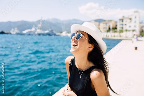 Beautiful brunette portrait, walking down the dock by the sea
