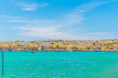 In de dag Groene koraal View of maltese city Marsaxlokk
