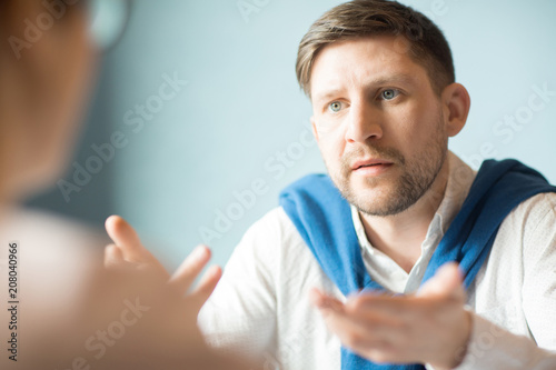 Valokuva  Dissatisfied businessman having unpleasant conversation with colleague in nice cafe