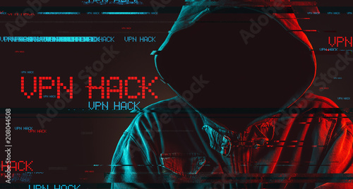 VPN hack concept with faceless hooded male person - Buy this stock