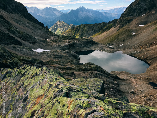 Deurstickers Landschap Small Deep Blue Glacial Lake in Rocky Alpine Landscape (Switzerland)