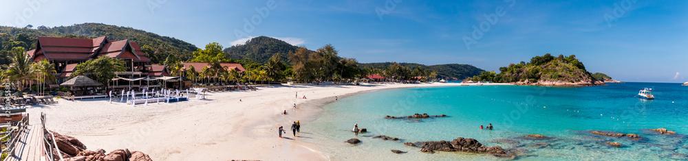 Fototapeta Beautiful panoramic view of Long Beach (Pasir Panjang) on Redang Island in Terengganu, Malaysia. Tourists enjoying their leisure time along the white powdery sand beach and crystal clear blue water.