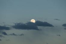 Bright Moon Among Dark Clouds ...