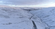 Aerial Shot Of Snow Covered Valley In North Yorkshire.