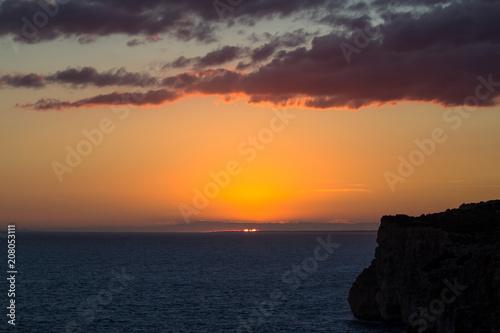 Spoed Foto op Canvas Zee zonsondergang Sunset over sea