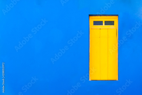 Papiers peints La Havane Colourful colonial Caribbean tropical style blue facade closed window in a bright and intense blue wall house background.