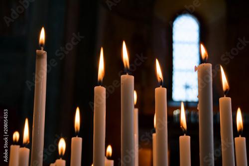 Cuadros en Lienzo Devotional candles lit inside a church.