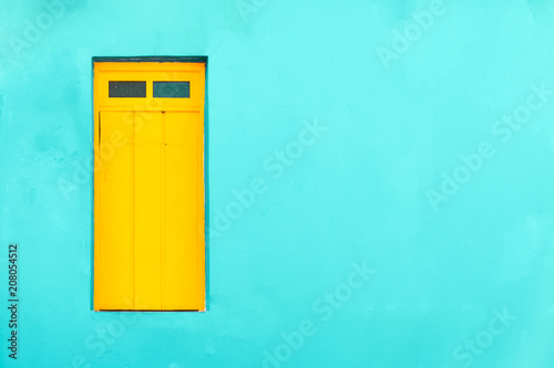 Poster de jardin Havana Colourful colonial Caribbean tropical style cyan facade with yellow closed window in a bright cyan wall house background.