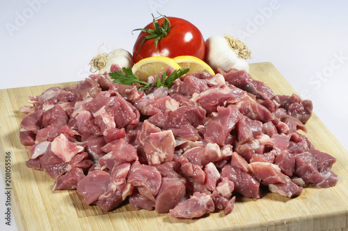Poster Vlees Raw chopped lamb meat on a wooden cutting board on a slate