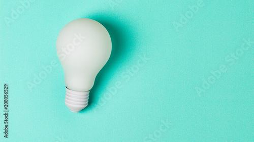 Fototapeta white light bulb on blue background obraz na płótnie