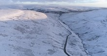 Aerial Shot Of Flying Over A Snowy Valley In North Yorkshire.