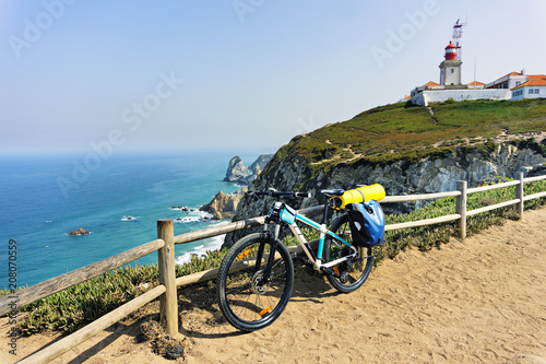Fotografia  Tourist bike is parked on the westernmost point of the continent Europe