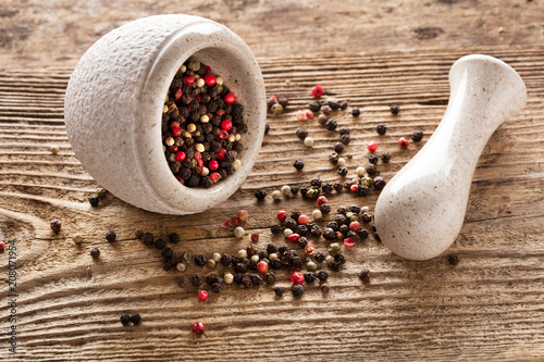 Fotobehang Kruiderij mixed peppercorns in bowl on wooden background