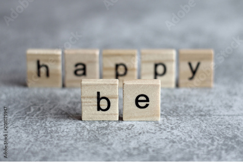 Be happy word written on wood cube Poster
