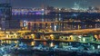 Dubai creek landscape night timelapse with boats and ship near waterfront