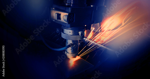 Cutting of metal. Sparks fly from laser Fototapet