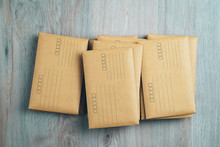 Stacked Brown Envelopes On Woo...