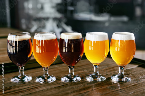 Beer Glasses On Wooden Table Closeup