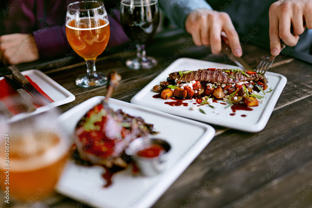 Fototapety, obrazy: Food In Restaurant. Meat Dishes And Beer On Table