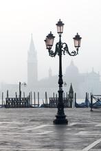 Lamp And St. Mark's Square With Grand Canal And Church Of San Giorgio Maggiore In The Background, Venice, Veneto
