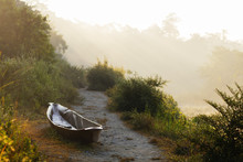 Canoe On A Riverbank At Dawn, Chitwan National Park, Nepal
