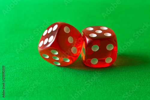 Dice on a green background . Game concept. Games of chance Poster