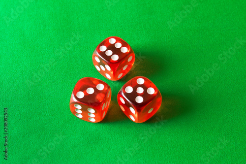 Dice on a green background . Game concept. Games of chance плакат