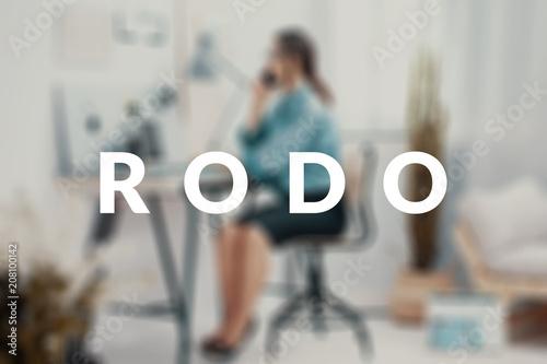 Fotografie, Tablou  Blurred businesswoman talking on the phone