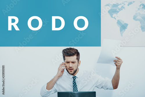 Businessman working in an international company talking on the phone in front of Fototapet