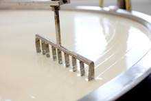 Machine Slicing Through Curdled Cheese Curds In Vat