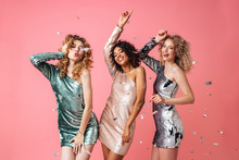 Three Beautiful Excited Women In Shiny Dresses