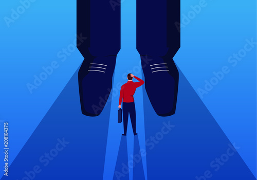 Fotografie, Obraz  Businessman stands at the feet of giants