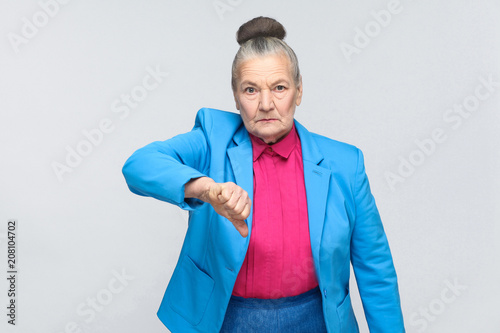 Fotografie, Obraz Unhappy woman showing dislike sign
