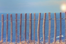 Wooden Fence In Front Of Sea A...