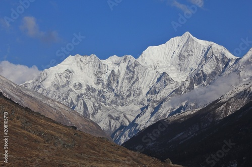 Fotobehang Asia land Beautiful shaped mount Gangchenpo on a clear spring day. Scene in the Langtang national Park, Nepal.