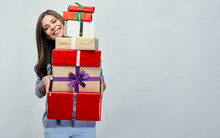 Happy Woman Holding Gift Pile,...