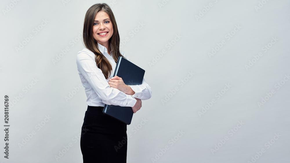 Fototapeta Business woman holding laptop. Isolated portrait
