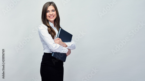 Fotografia  Business woman holding laptop. Isolated portrait