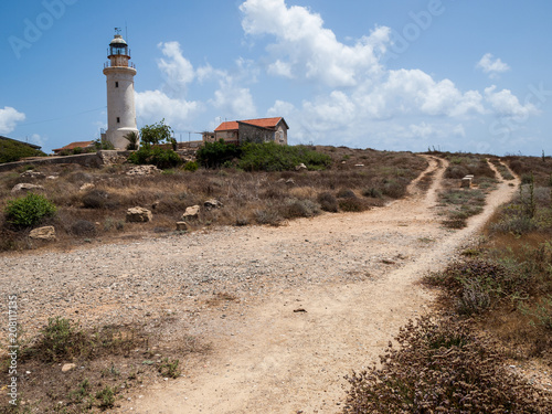 Staande foto Cyprus Paphos Lighthouse, well known lighthouse on the island Cyprus, near town Paphos, Cyprus