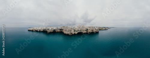 Fotografie, Obraz  Polignano a Mare Apulia City Sea Coastline and white houses in Italy Drone 360 v